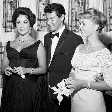 LAS VEGAS - APRIL 03 : In this handout image provided by the Las Vegas News Bureau, Eddie Fisher poses with his soon-to-be-divorced wife Debbie Reynolds, as well as, his soon-to-be-next wife Elizabeth Taylor at the Tropicana Hotel on April 3, 1957 in Las Vegas, Nevada. kicking off the scandal of the decade. (Photo by Las Vegas News Bureau Archives via Getty Images)