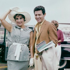 Elizabeth Taylor and Eddie Fisher, circa 1960. Taylor wears a black and white checked outfit with white wide brimmed hat and gloves. (Photo by Archive Photos/Getty Images)